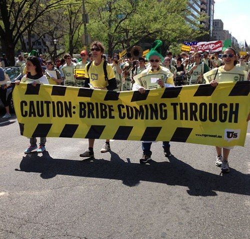 """Caution Bribe Coming Through."" March in Washington, DC, April 13, 2013, by Represent.Us"