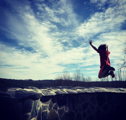 A child jumping from a high height - Credit: Josh Durham