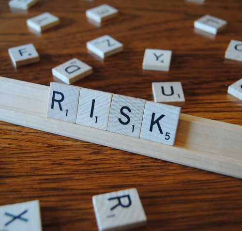 "Scrabble letter tray with the word ""RISK"""