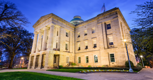 The North Carolina State Capitol building during the early evening hours.