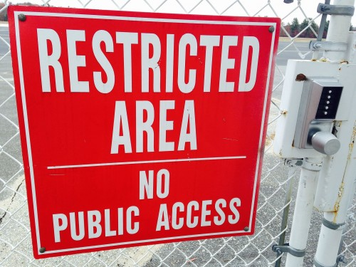 "Sign which reads ""Restricted Area No Public Access"""